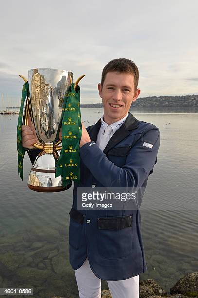 Scott Brash holds the Rolex IJRC Top Ten trophy from riding Hello Sanctos and winning the Rolex IJRC Top 10 Final on Lake Geneva on December 13 2014...