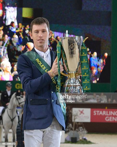 Scott Brash holds the trophy from riding Hello Sanctos and winning the Rolex IJRC Top 10 Final on December 12 2014 in Geneva Switzerland