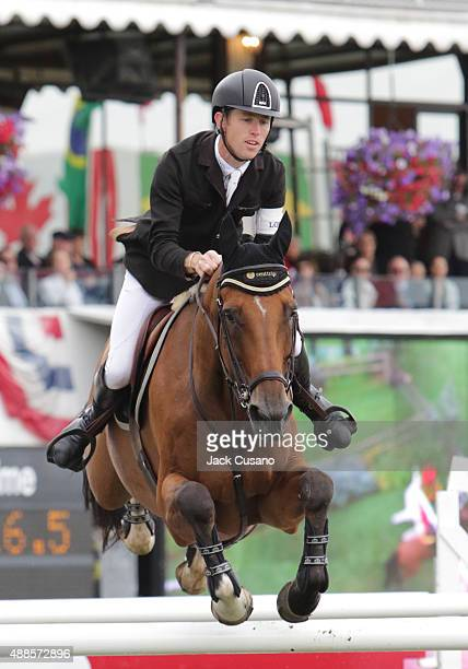 Scott Brash of GBR riding Hello Sanctos clears a jump and wins the Rolex Grand Slam and the CP International Grand Prix at the Spruce Meadows Masters...