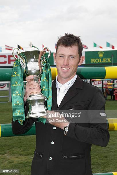 Scott Brash of GBR riding Hello Sanctos holds the Rolex Cup after winning the Rolex Grand Slam and the CP International Grand Prix at the Spruce...