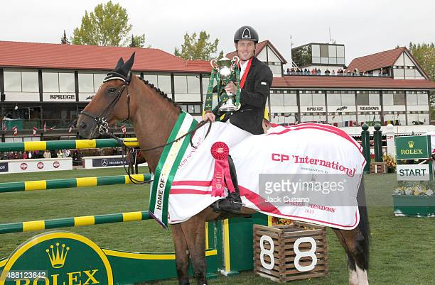 Scott Brash of GBR riding Hello Sanctos holds the Rolex trophy after winning the Rolex Grand Slam and the CP International Grand Prix at the Spruce...