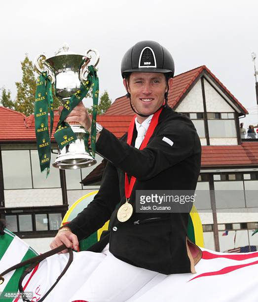 Scott Brash of GBR riding Hello Sanctos holds up the Rolex Trophy after winning the Rolex Grand Slam and the CP International Grand Prix at the...