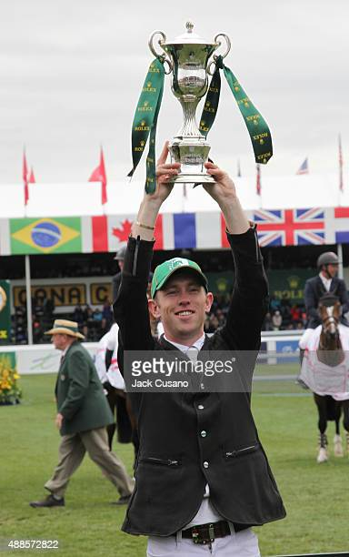 Scott Brash of GBR riding Hello Sanctos holds up the Rolex trophy after wining the Rolex Grand Slam and the CP International Grand Prix at the Spruce...