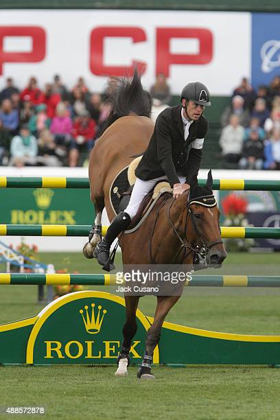 Scott Brash of GBR riding Hello Sanctos lands after clearing a jump and wins the Rolex Grand Slam and the CP International Grand Prix at the Spruce...
