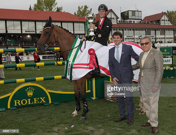 Scott Brash of GBR riding Hello Sanctos poses for a winning photo with Rolex executives after winning the Rolex Grand Slam and the CP International...