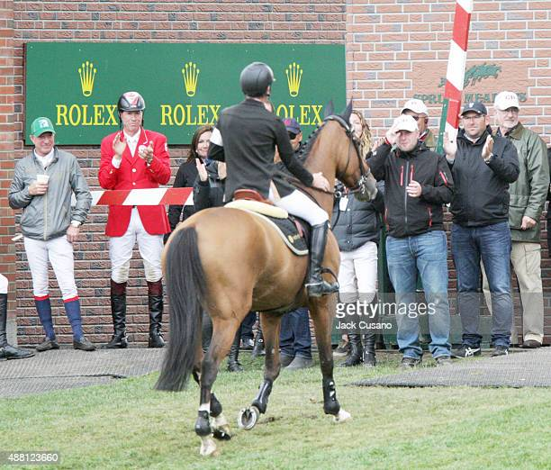 Scott Brash of GBR riding Hello Sanctos receives cheers from fellow riders and handlers after winning the Rolex Grand Slam and the CP International...