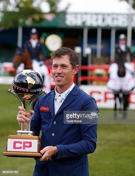Scott Brash of Great Britain hoists the Spruce Meadows CP International Grand Prix trophy after he won the event on September 11 2016 in Calgary...