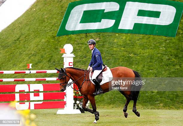 Scott Brash of Great Britain reacts to a clear round on his horse Ursula XII during the Spruce Meadows CP International Grand Prix on September 11...
