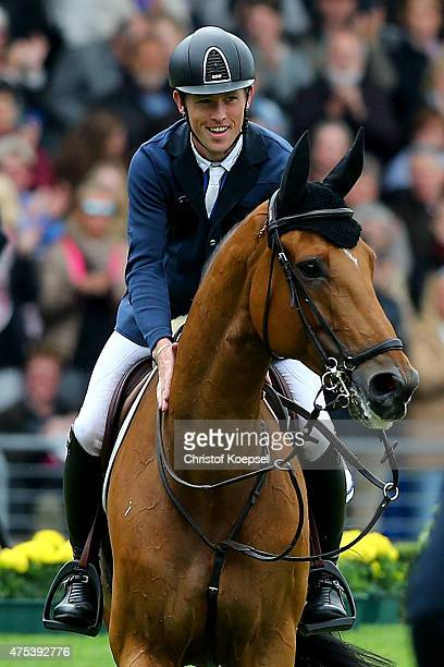 Scott Brash of GreatBritain rides on Hello Sanctos celebrates after winning the Rolex Grand Prix jumping competition of the 2015 CHIO Aachen...