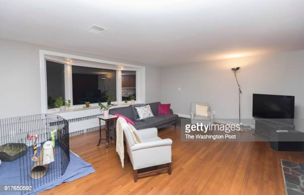 Scott Brewer left Sarah Wright and Laszlo the rabbit have their room photographed for a redesign on Thursday September 21 2017 in Silver Spring MD