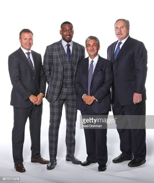 Scott Brooks John Wall Ted Leonsis and Ernie Grunfeld of the Washington Wizards pose for a portrait after announcing a new contract for John Wall at...