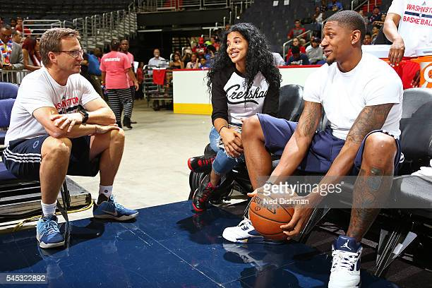Scott Brooks talks to Bradley Beal of the Washington Wizards talk during an open practice for fans on June 6 2016 at the Verizon Center in Washington...