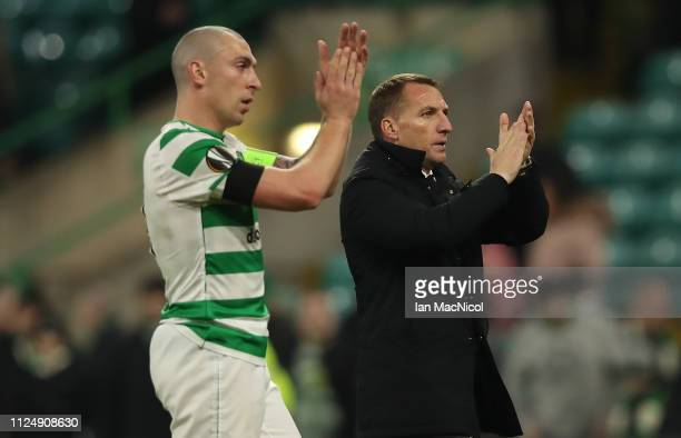 Scott Brown and Celtic manager Brendan Rodgers are seen during the UEFA Europa League Round of 32 First Leg match between Celtic and Valencia at...
