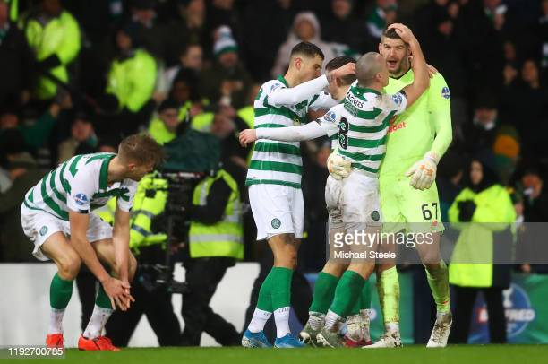 Scott Brown and Fraser Forster of Celtic celebrate victory with teammates following the Betfred Cup Final between Rangers FC and Celtic FC at Hampden...