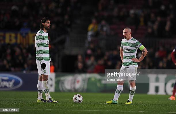Scott Brown and Georgios Samaras of Celtic FC react after FC Barcelona scored their 6th goal during the UEFA Champions League Group H match between...
