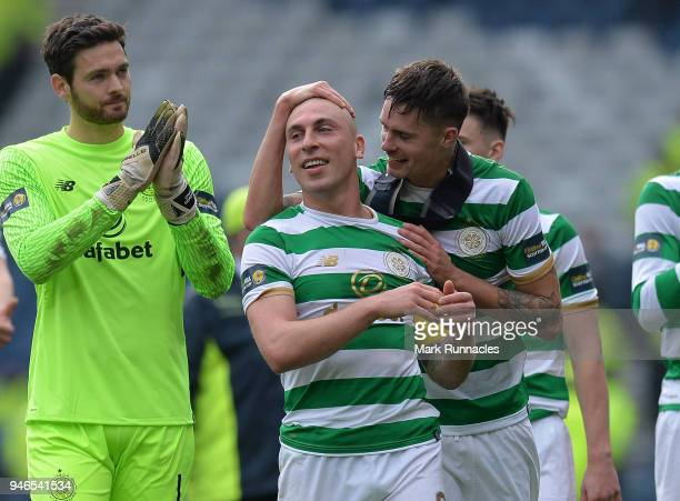 Scott Brown and Mikael Lustig of Celtic celebrates at the final whistle as Celtic beat Rangers 40 during the Scottish Cup Semi Final match between...
