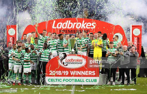 Scott Brown and Mikael Lustig of Celtic hold the league championship trophy as they celrbate with team mates after the Ladbrokes Scottish Premiership...