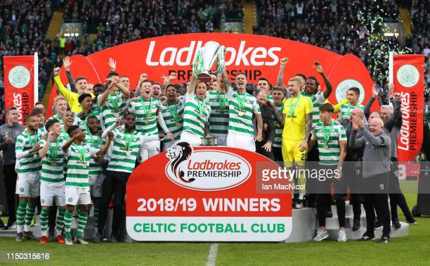 Scott Brown and Mikael Lustig of Celtic lift the league championship trophy in celebration after the Ladbrokes Scottish Premiership match between...