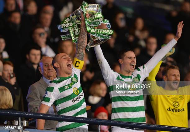 Scott Brown and Mikael Lustig of Celtic lift the League Cup Trophy during the Betfred Cup Final between Celtic and Aberdeen at Hampden Park on...