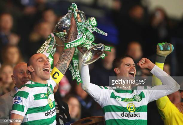 Scott Brown and Mikael Lustig of Celtic lift the trophy in victory after the Betfred Cup Final between Celtic and Aberdeen at Hampden Park on...