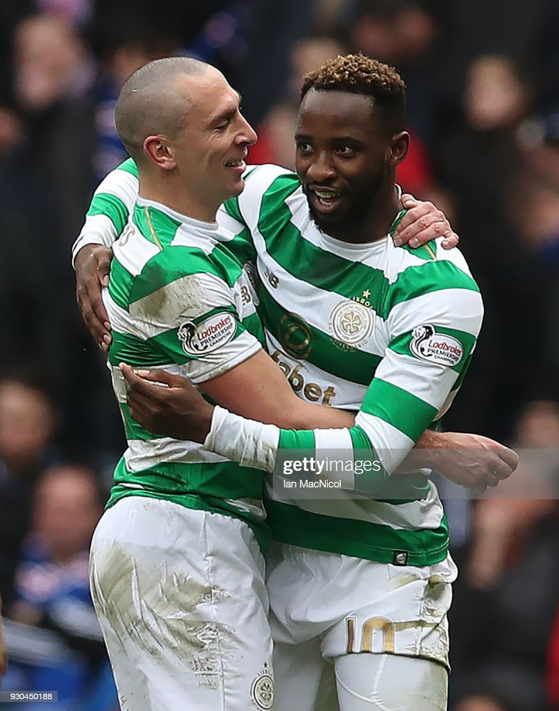Scott Brown and Moussa Dembele of Celtic celebrate during the Rangers v Celtic Ladbrokes Scottish Premiership match at Ibrox Stadium on March 11, 2018 in Glasgow, Scotland.