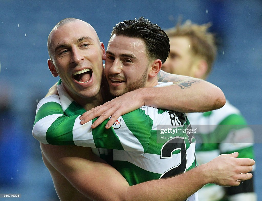 Scott Brown (L) and Patrick Roberts (R) of Celtic celebrate their 2-1 win after the Ladbrokes Scottish Premiership match between Rangers and Celtic at Ibrox Stadium on December 31, 2016 in Glasgow, Scotland.