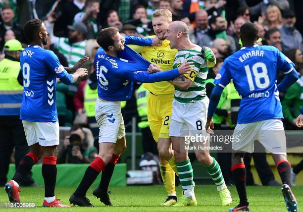 Scott Brown and Scott Bain of Celtic are confronted by Andy Halliday of Rangers at the final whistle during the Ladbrokes Scottish Premiership match...