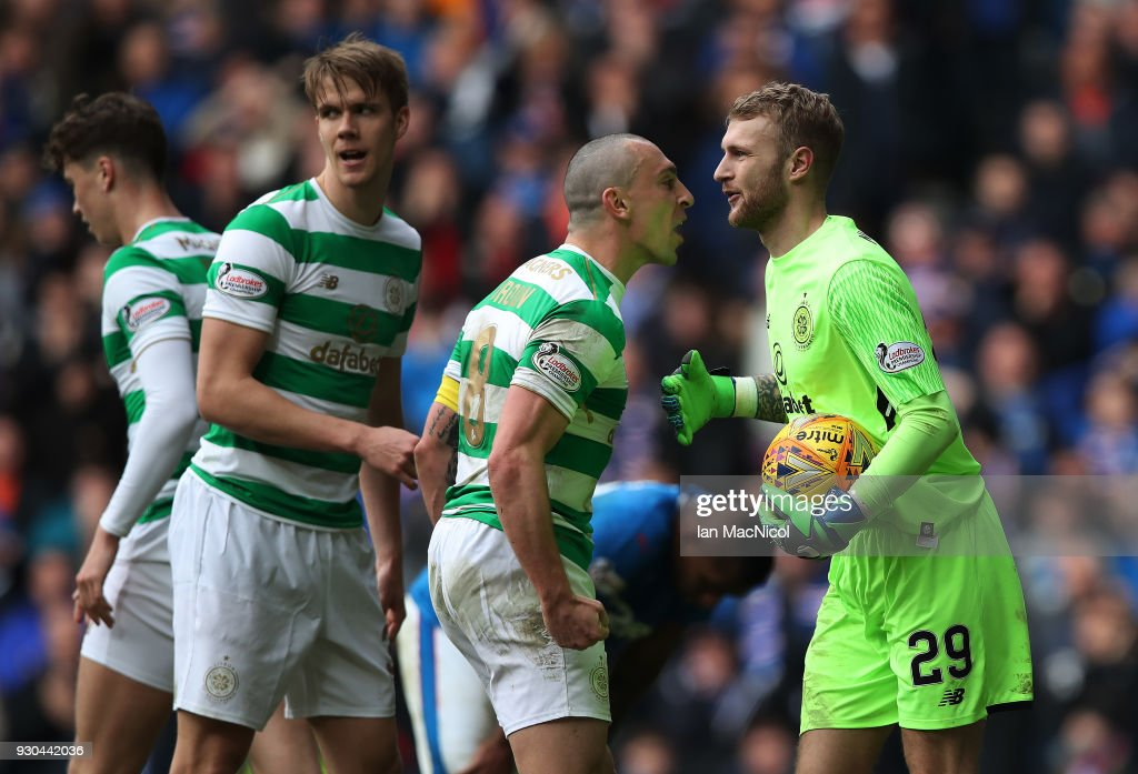 Scott Brown and Scott Bain of Celtic react during the Rangers v Celtic Ladbrokes Scottish Premiership match at Ibrox Stadium on March 11, 2018 in Glasgow, Scotland.