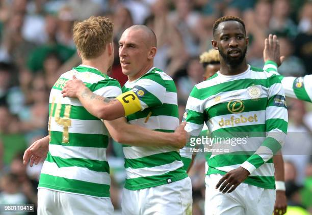 Scott Brown and Stuart Armstrong of Celtic celebrate following the Scottish Cup Final between Motherwell and Celtic at Hampden Park on May 19 2018 in...