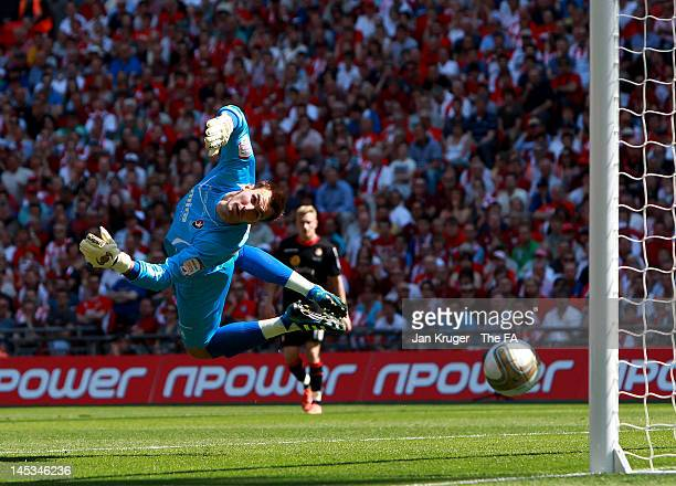 Scott Brown, goalkeeper of Cheltenham Town fails to deal with a shot at goal during the npower League Two Playoff Final match between Cheltenham Town...