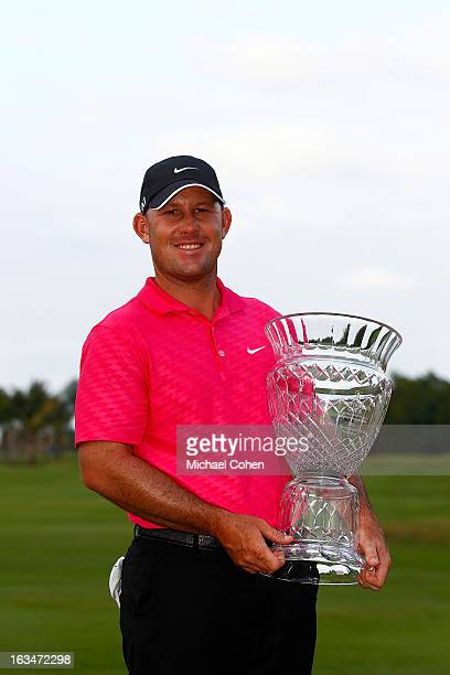 Scott Brown holds the trophy after the final round of the Puerto Rico Open presented by seepuertoricocom held at Trump International Golf Club on...