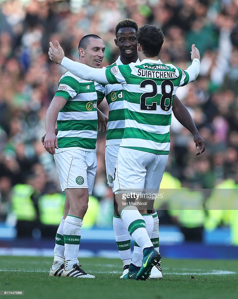 Scott Brown, Moussa Dembele and Erik Sviatchenko of Celtic celebrate at full time during the Betfred Cup Semi Final match between Rangers and Celtic at Hampden Park on October 23, 2016 in Glasgow, Scotland.