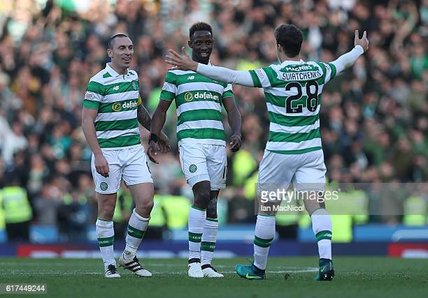 Scott Brown Moussa Dembele and Erik Sviatchenko of Celtic celebrate at full time during the Betfred Cup Semi Final match between Rangers and Celtic...