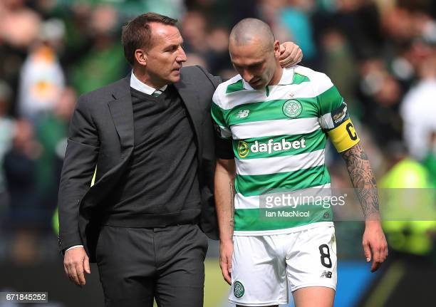 Scott Brown of Celtic and Celtic Manager Brendan Rodgers are seen during the William Hill Scottish Cup semifinal match between Celtic and Rangers at...