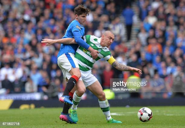 Scott Brown of Celtic and Emerson Hyndman of Rangers compete for the ball during the Scottish Cup SemiFinal match between Celtic and Rangers at...