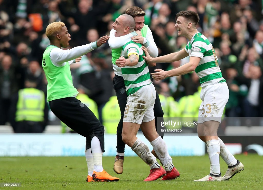 Scott Brown of Celtic and his team mates celebrate victory after the Ladbrokes Scottish Premiership match between Rangers and Celtic at Ibrox Stadium on March 11, 2018 in Glasgow, Scotland.