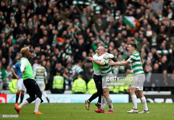 Scott Brown of Celtic and his team mates celebrate victory after the Ladbrokes Scottish Premiership match between Rangers and Celtic at Ibrox Stadium...