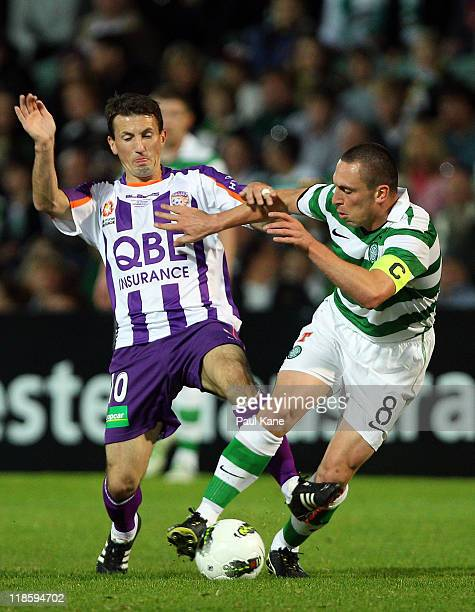 Scott Brown of Celtic and Liam Miller of the Glory contest the ball during the international friendly club match between the Perth Glory and Glasgow...