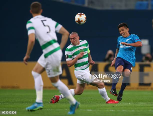 Scott Brown of Celtic and Matías Kranevitter of FC Zenit Saint Petersburg vie for the ball during the UEFA Europa League Round of 32 football match...