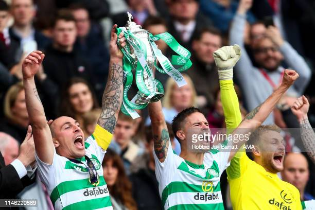 Scott Brown of Celtic and Mikael Lustig of Celtic celebrate with the William Hill Scottish Cup during the William Hill Scottish Cup final between...