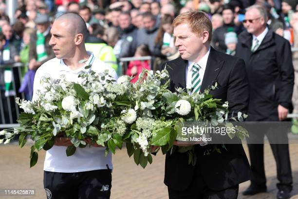 Scott Brown of Celtic and Neil Lennon Interim manager of Celtic carry a wreath in tribute to Celtic legend Billy McNeill prior to the Ladbrokes...