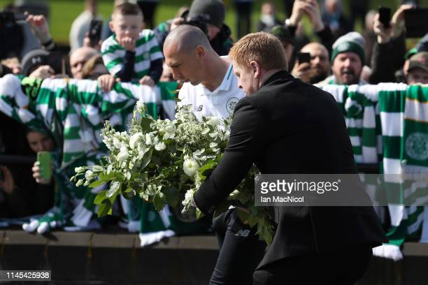 Scott Brown of Celtic and Neil Lennon Interim manager of Celtic lay a wreath in tribute to Celtic legend Billy McNeill prior to the Ladbrokes...