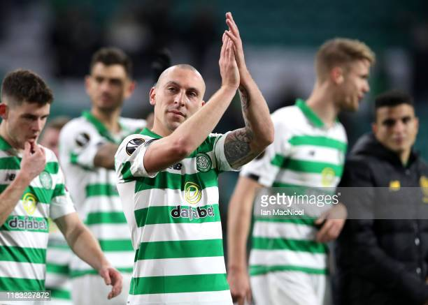 Scott Brown of Celtic applauds fans following their team's victory in the UEFA Europa League group E match between Celtic FC and Lazio Roma at Celtic...