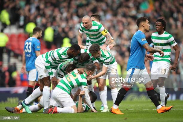 Scott Brown of Celtic celebrates after Tom Rogic of Celtic scores the opening goal during the Scottish Cup Semi Final between Rangers and Celtic at...