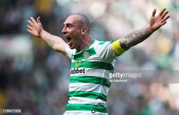 Scott Brown of Celtic celebrates at full time during The Ladbrokes Scottish Premier League match between Celtic and Rangers at Celtic Park on March...