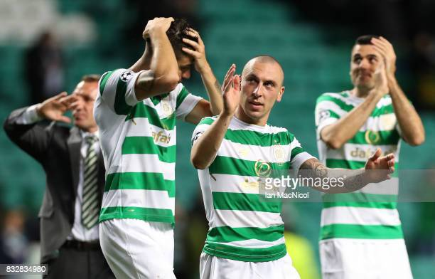 Scott Brown of Celtic celebrates at full time during the UEFA Champions League Qualifying PlayOffs Round First Leg match between Celtic FC and FK...
