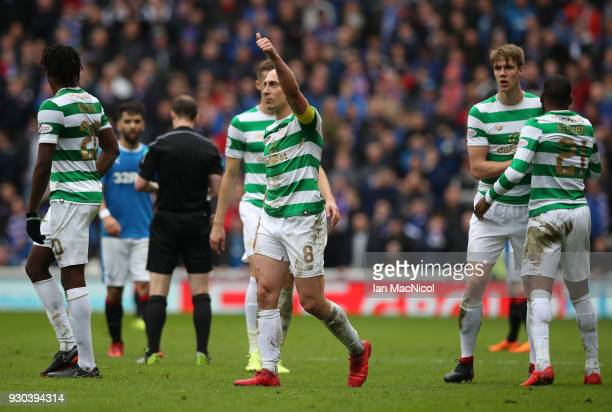 Scott Brown of Celtic celebrates his sides second goal with his Celtic team mates during the Ladbrokes Scottish Premiership match between Rangers and...