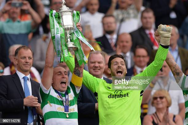 Scott Brown of Celtic holds the Scottish Cup Trophy following his side's win at the Scottish Cup Final between Motherwell and Celtic at Hampden Park...