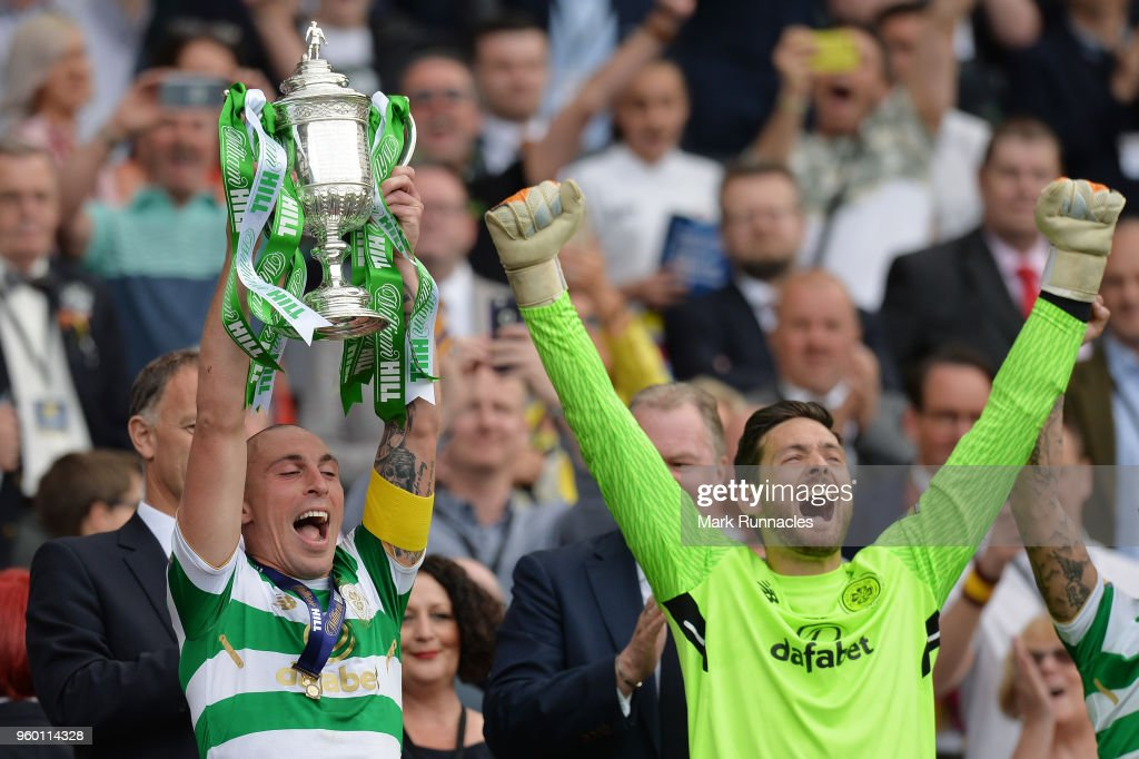 Scott Brown of Celtic holds the Scottish Cup Trophy following his side's win at the Scottish Cup Final between Motherwell and Celtic at Hampden Park on May 19, 2018 in Glasgow, Scotland.