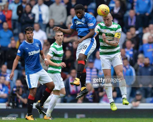 Scott Brown of Celtic is challenged by Aaron Nemane of Rangers during the Ladbrokes Scottish Premiership match between Rangers FC and Celtic FC at...